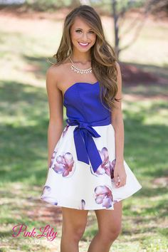 This strapless dress is perfect for warmer weather! With a sweetheart neckline, a waist tie belt, and a slightly ruffled skirt, this dress brings a floral punch to your wardrobe.