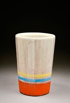 Alex Reed. Good use of clay body color. Glaze makes me think of knee high tube socks.
