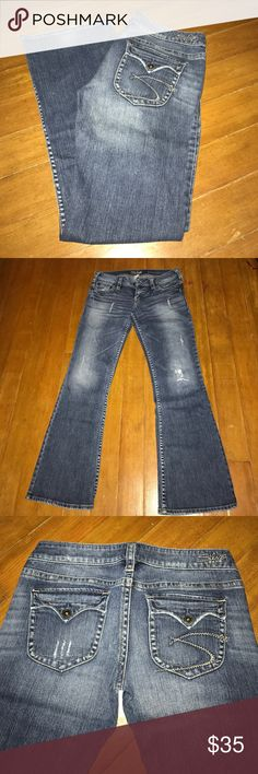 Silver Pioneer Jeans LIKE NEW! Silver Jeans Pioneer boot cut distressed 28x31. Embroidered back button flap pockets. Comes from a smoke free home. Silver Jeans Jeans Boot Cut