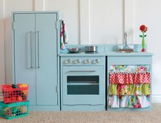 turn an old entertainment center into a childrens play kitchen