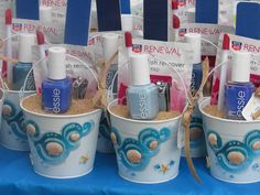 Beach Baby shower favors. Love this (we'd do it in pink) and I can't find a link to the little buckets, but maybe we can find them somewhere.