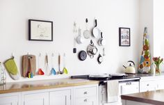 """""""Give your kitchen a colour injection, make a style statement and save space by hanging your kitchen essentials above the workspace using COMMAND HOOKS and Command Small Wire Hooks."""" I always forget how smart these are to use! Military Housing Decorating, Kitchen Organisation, Organization, Organizing, Tidy Kitchen, Kitchen Ideas, Command Hooks, Command Strips, Craft Room Storage"""