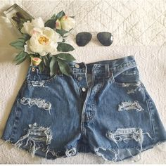 Levi's High Waisted Distressed Shorts So cute and perfect for summer! Bought at a thrift boutique so there's an XS written on the tag, but I definitely would not categorize these as an extra small Levi's Shorts Jean Shorts