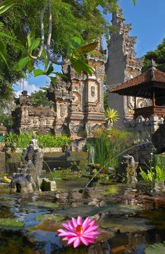 Bali, Indonesia....the traditional gate entrance of Bali Temples or houses with the beautiful water garden