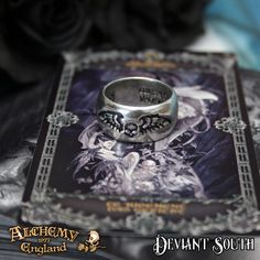 Last Chance! Alchemy Gothic AG-R207 Desolation ring  A polished pewter band ring, engraved on two sides with a black, spreadeagled, winged skull.