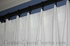 EXAMPLE OF EUROPLEATED DRAPERY ATTACHED TO ROD USING CLIPS. SHEER DRAPES, POSITIONED AS PANELS FOR LIVING ROOM. STATIONARY PANELS FOR DINING ROOM.