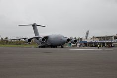 A Royal Australian Air Force (RAAF) C-17A Globemaster aircraft comes to a stop at Vanuatu's international airport before unloading emergency relief supplies and Australian Defence Force and Department of Foreign Affairs and Trade personnel on 15 March 2015.
