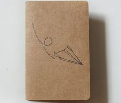 Paper Airplane Moleskine journal.....best journals, I use them to take classroom notes!