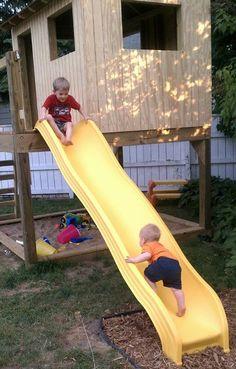 Backyard playhouse and sandbox