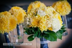 Simple and Modern In Wisconsin.  Yellow and pewter wedding bouquets.