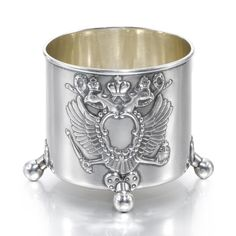 A Fabergé silver cup, Moscow, 1899-1906, the front cast with the Imperial Eagle, four ball feet, struck K.Fabergé beneath the Imperial Warrant, 84 standard, scratched inventory number 21152