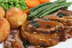 Photo about Roast lamb dinner with mint sauce and gravy. Image of meat, peas, mint - 3442895 Salmon Recipes, Pork Recipes, Spit Roast Catering, Bbq Spit, Lamb Dinner, Great Recipes, Favorite Recipes, Mint Sauce, Food Preparation