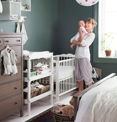 Great way to create a shared nursery space using white baby furniture and a surprising wall color. What if I combined this with navy & white crib bedding...?
