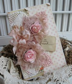 Lovely and aged...for a dear friend...embellished with papers, tea stained chiffon roses, paper roses in the center, tea stained leaves, tea stained shabby tag, vintage crochet doily, and handmade stick pins with glass beads.