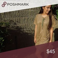 💘BOGO💘Brown Faux suede shift Lace up dress Gorgeous tan faux suede shift dress! Total score for you. Front has 2 pockets and lace front. This dress would pair very well with some boots. Perfect for your fall wardrobe.  •No Trades• Boutique  Dresses