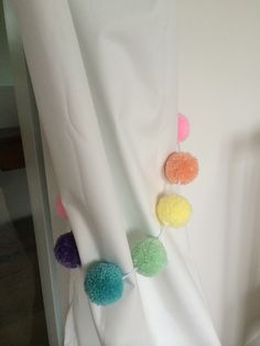 Curtain tie backs made using Pom Pom garland by JustEmbellish purchased via Etsy
