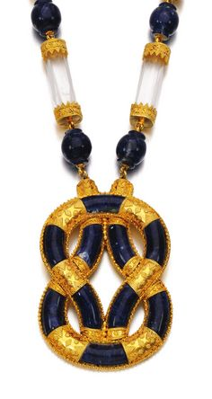 Rock crystal and sodalite necklace, Ilias Lalaounis, 1970s:  Designed as a series of facetted rock crystal batons alternating with sodalite beads, suspending a pendant designed as a Herakles knot inset with panels of sodalite with granulation detail, length approximately 600mm, signed Ilias Lalaounis, maker's mark, pouch stamped Ilias Lalaounis.