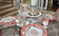 This one is a repin called Seashell Tablescape 8 from thepaintedapron.com. Its very pretty. I love the ruffled chargers or placemats beneath the plates too