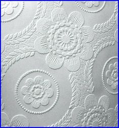 Decorative plasterwork finishes for ceilings made by cutting out shapes from embossed wallpaper, gluing them to ceiling and painting over them(made need several coats) - get wallpaper samples from DIY places