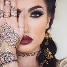 ig:hudabeauty: Gorgeous @hellyluv #hudabeautylipcontour @shophudabeauty lashes & henna sticker tattoos