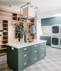 Everything about this laundry + mudroom + closet by McGee and Company is so inspiring to me. I love the hunter green cabinets, the plaid carpet and the center island. This room is almost too beautiful to do laundry in! Laundry Room Island, Mudroom Laundry Room, Laundry Room Design, Mudroom Cabinets, Kitchen Design, Custom Home Builders, Custom Homes, Modern Laundry Rooms, Laundry Room Inspiration