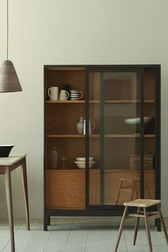 Japanese influence with a brilliant mid-century take. Would be perfect as a display cabinet in our dining room.