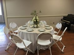 Erica York hosted and created this beautiful Holiday Table with white roses.