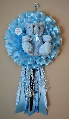 "This charming ""It's a Boy"" wreath is perfect to hang on the door at a baby shower, hospital room, and nursery, so that everyone knows about your bundle of joy! This is a great gift for a baby shower or newborn, and will definitely make mom feel special."