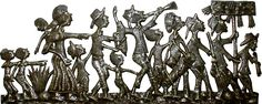 "Enjoy the happiness of this Haitian Rara band marching, singing and playing their primitive instruments. Hand cut from recycled 50 gallon steel drum. Very detailed. Measures 14"" x 34"". www.HaitiMetalArt.com"