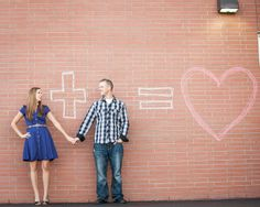 Adorable engagement photo, with the turds and chalk in their hands!