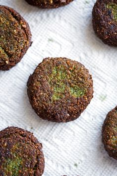 The Best Homemade Falafels - Traditional restaurant style falafels -- made at home! These tiny falafels are super easy to make at home and are loaded with traditional flavors like sesame seeds, tons of parsley and a hint of cumin.