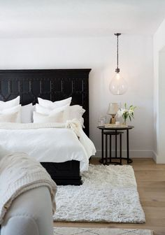 """On the master bedroom: """"The client's favorite color palette is black and white so we stuck to mainly those tones for this space. The focus on this room was to emphasize layers and textures to..."""