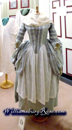 1760s - robe a l'anglaise with fourreau style back; blue and cream 'ribbon-stripe' silk repaired and refurbished for display. 18th century quilted petticoat and apron.