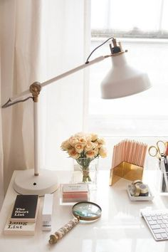 15 Things Every Single Fashion Blogger Has on Her Desk - white lamp, gold pencil holder, flowers + magnifying glass