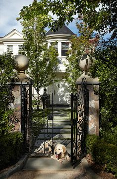 Enchanting entry gate and romantic turret on this Victorian house