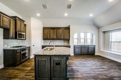 If you like brown kitchens, then this one is for YOU! Also, check out that window seat ❤️ Brown Kitchens, Home Kitchens, Bloomfield Homes, Kitchen Ideas, Kitchen Design, New Home Builders, New Homes For Sale, Hardwood Floors, Sweet Home