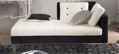 Monochrome domino day bed by Designers Guild for a luxurious look