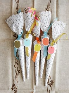 These would be SO inexpensive to make for a wedding (and fill with like, peanuts or jelly beans) - paper favor cones, Rebecca Thuss