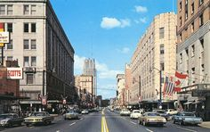 Downtown Akron Ohio in the '60s.  O'Neil's Department Store is the big gray building on the left and Polsky's Department Store is on the right.  This postcard brings back a lot of memories!