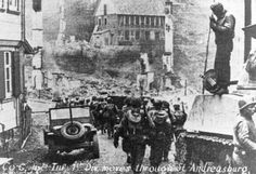 G Company passes through St. Andreasburg onto their next attack, 15 April 1945.