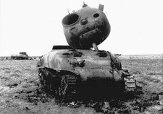 A Sherman tank with the turret blown clear off...