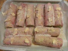 Mettere sugli involtini qualche ciuffetto di burro, cospargere con il pangrattato e il parmigiano grattugiato e infornare