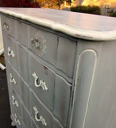 Beautiful French Provincial Highboy refinished in Annie Sloan chalk paint...Paris Gray and accented in Old White, hand rubbed clear wax and moderately distressed for a rustic farmhouse finish.