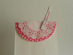 Cute bag topper idea - doily over a cupcake liner - complete with a clothespin