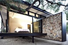 archatlas:     Floating Stone Wall Residence in Johannesburg        The Westcliff Pavilion by GASS   is a steel-framed pavilion structure located in Johannesburg, South Africa.    From the architects:    This 2 bedroom dwelling, nestled away in its wooded surroundings, is positioned just before the inception of a major sheer face of the Westcliff Ridge. This affords the building a private, tranquil hiding place in the trees juxtaposed with a feeling of floating above the ridge combined…