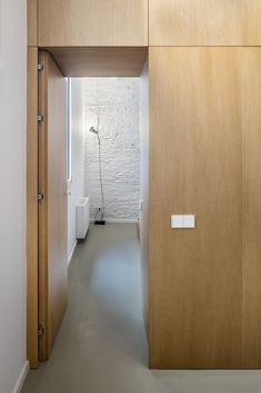 Gallery of Interior Refurbishment / Alventosa Morell Arquitectes - 5 Flush Door Design, Flush Doors, Interior Architecture, Interior Design, Wood Cladding, Hidden Rooms, Built In Furniture, Office Interiors, House Rooms