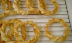 Tasty parmesan cheese and buttery pastry combined are great any time of year, but twist them into wreaths and they are perfect Christmas fare. Try these easy yummy wreaths this festive season as a fast entrée or snack at your next Christmas party.