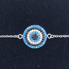 Kara Nano and Pave Evil Eye Bracelet on Sterling- Nano turquoise and white and black pave stones make up this beautiful delicate evil eye bracelet. See our large collection of hamsa, evil eye and protections jewelry. http://www.bettinascollection.com/products/kara-pave-evil-eye-bracelet-on-sterling