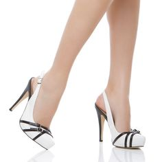 Kyna's classy lady with slingback silhouette and buckle accents. (white and black pumps)