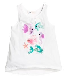 White/fish. Gently flared tank top in soft cotton jersey with a printed motif at front. Slightly longer at back.